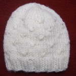 Wrapped Stitches Baby Hat for Straight Needles