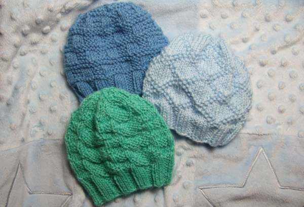 Free Knitting Pattern Baby Flower Hat : Textured Baby Hats for Straight Needles - Baby Clothing Knitted My Patterns -...